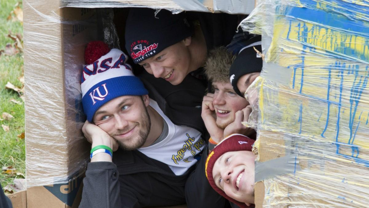 ATO members Cody Isabel, Reid Cobb, Trevor McKee and Michael Currie huddle inside a cardboard box to stay warm while raising money and awareness for the homeless for 24 hours. (Photo: Austin Hronich/The Simpsonian)