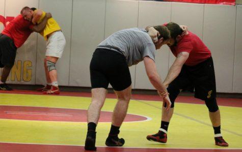 Wrestlers practice Greco-Roman wrestling during offseason