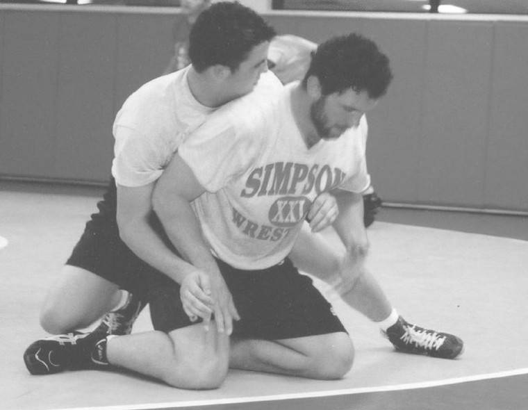 Wrestlers+prepare+to+hit+the+mats