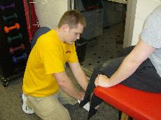 Athletic training majors perform athlete physicals