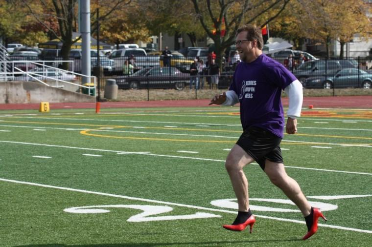 Men in heels take to field to raise awareness