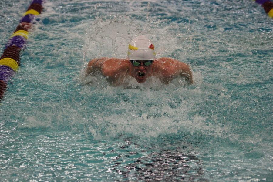 Men's and women's swimming split to open the season