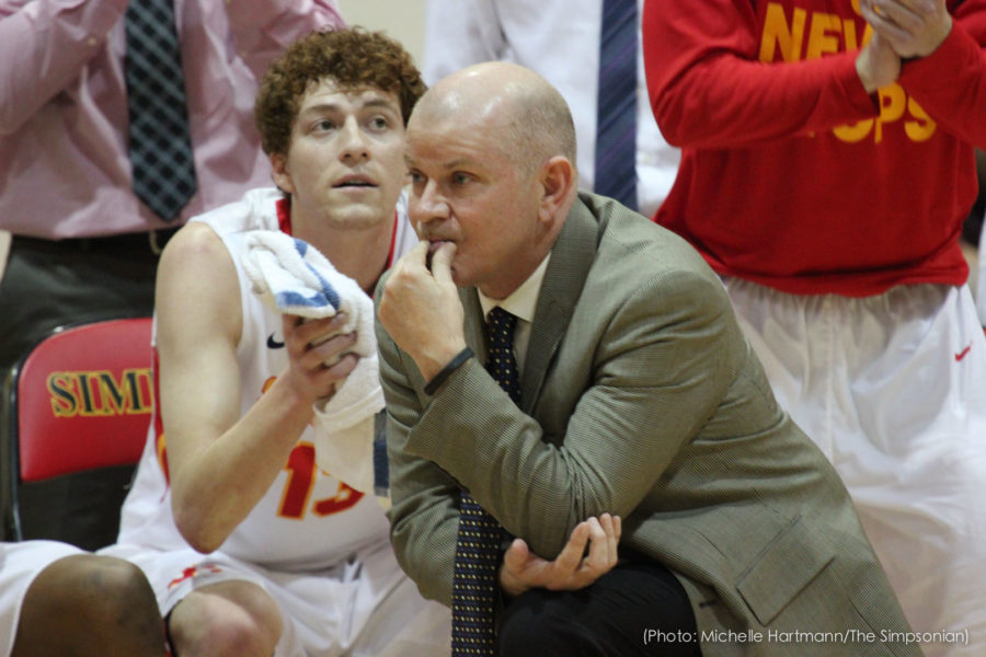 Men's basketball head coach prove worriers win