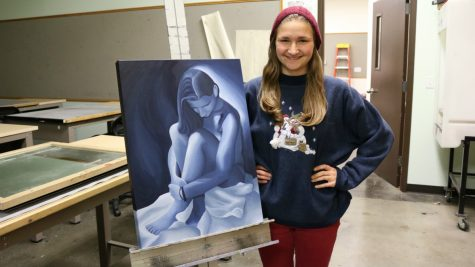 Junior Becca Schmidt painted her feelings about sexual assault: helplessness, brokenness and vulnerability. The piece was inspired by stories of her friends and her own experience with sexual assault. (Photo: Jayde Vogeler, Photography Editor/The Simpsonian)