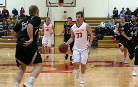 Men's basketball team clinches berth to IIAC Tournament