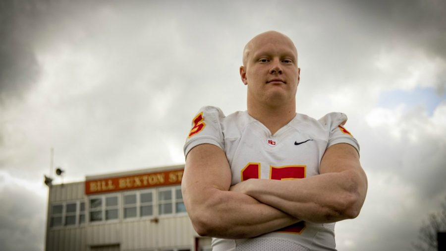 Finding family through football: Senior overcomes adversity