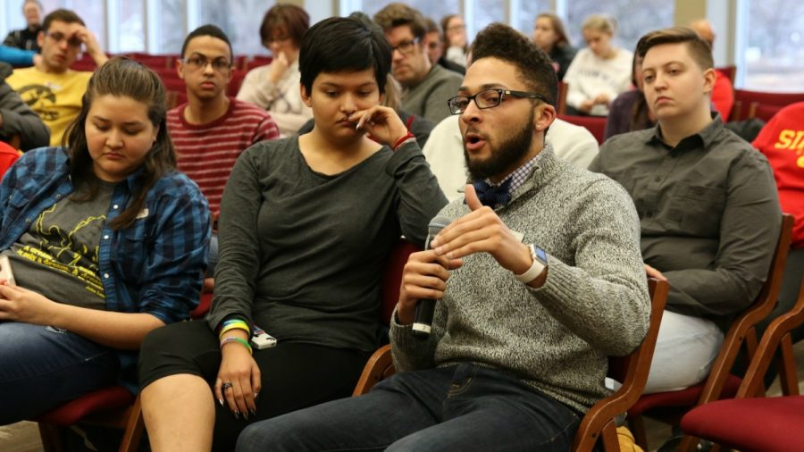Former Student Body Vice President Pierce Carey asks a question at an open forum discussing diversity and inclusion on campus. The event took place after a racially based threat was found on campus last week.  (Photo: Alex Kirkpatrick, managing editor/The Simpsonian)