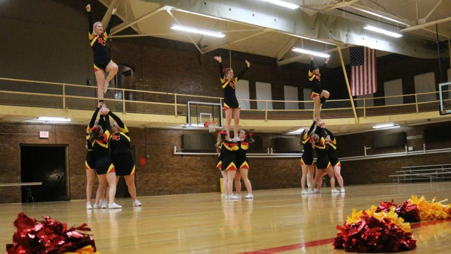 Simpson cheer heads to first IIAC competition