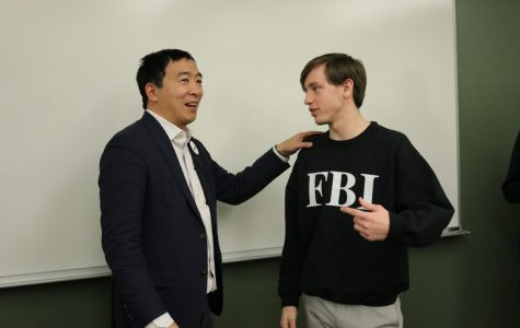 President of Simpson Democrats Geoff Van Deusen speaks to Andrew Yang after the candidate's campus event Thursday night. Photo by Coby Berg/The Simpsonian
