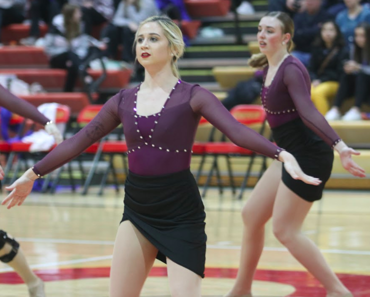 Rayann Otto dances at  halftime during the men's basketball game a week before the 2019 American Rivers Conference Cheer and Dance Invitationals. The Storm had two first place finishes and one second place finish.