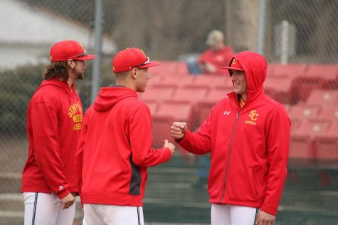 Senior baseball manager Steve Carlson (middle) is a critical key in keeping the team ticking. /photo contributed by Steve Carlson.