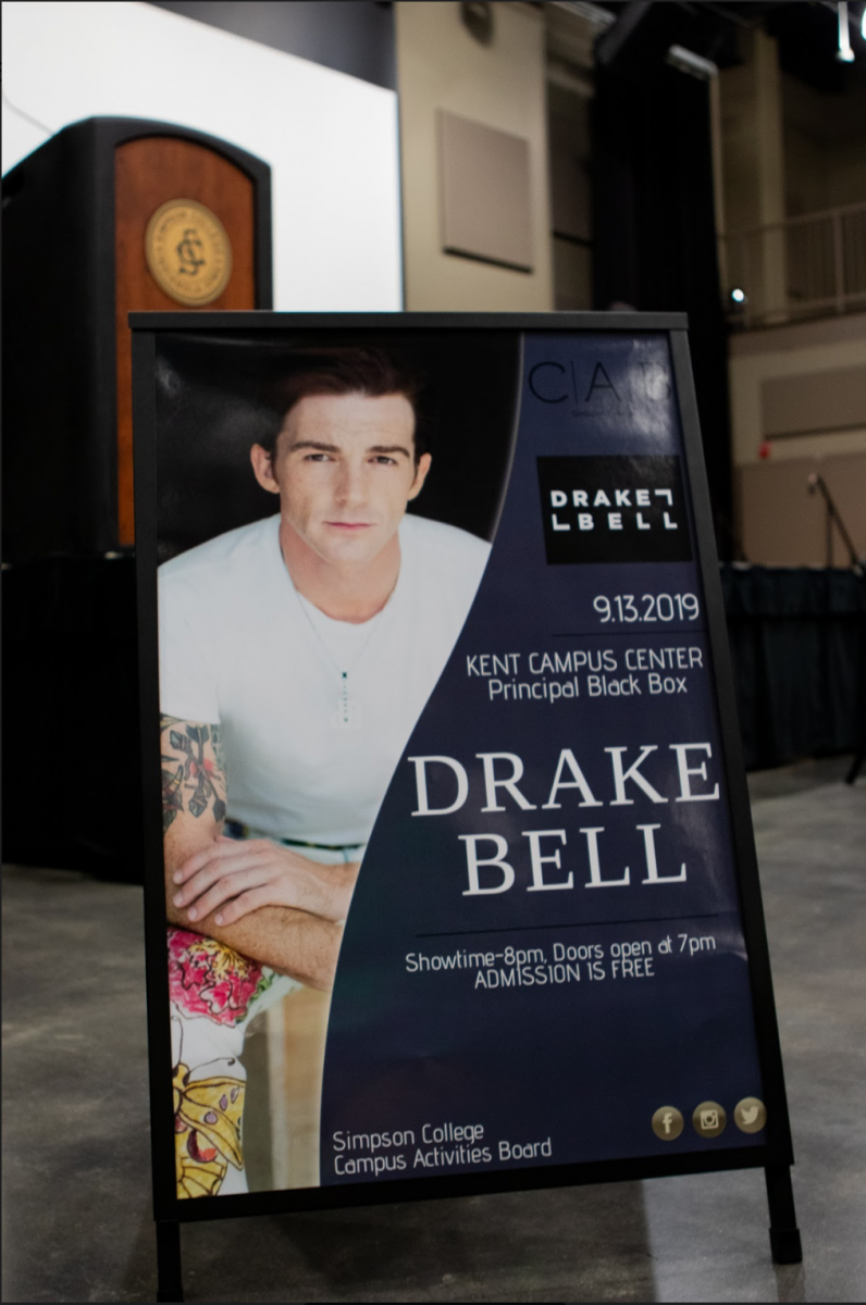 Drake Bell sign advertising the event in Kent Campus Center.