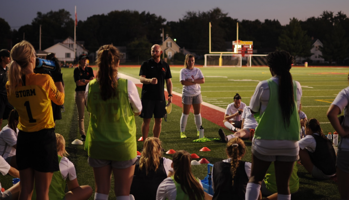 Coach talks to team at halftime.