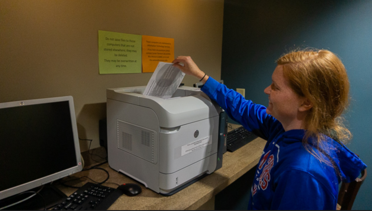 Whitney Kline prints off papers at Kent Campus Center