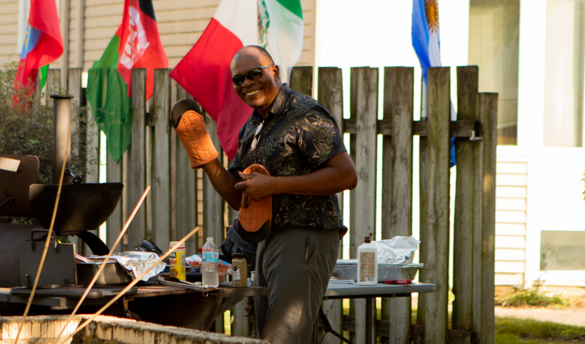 Walter Lain cooks some food on the grill.