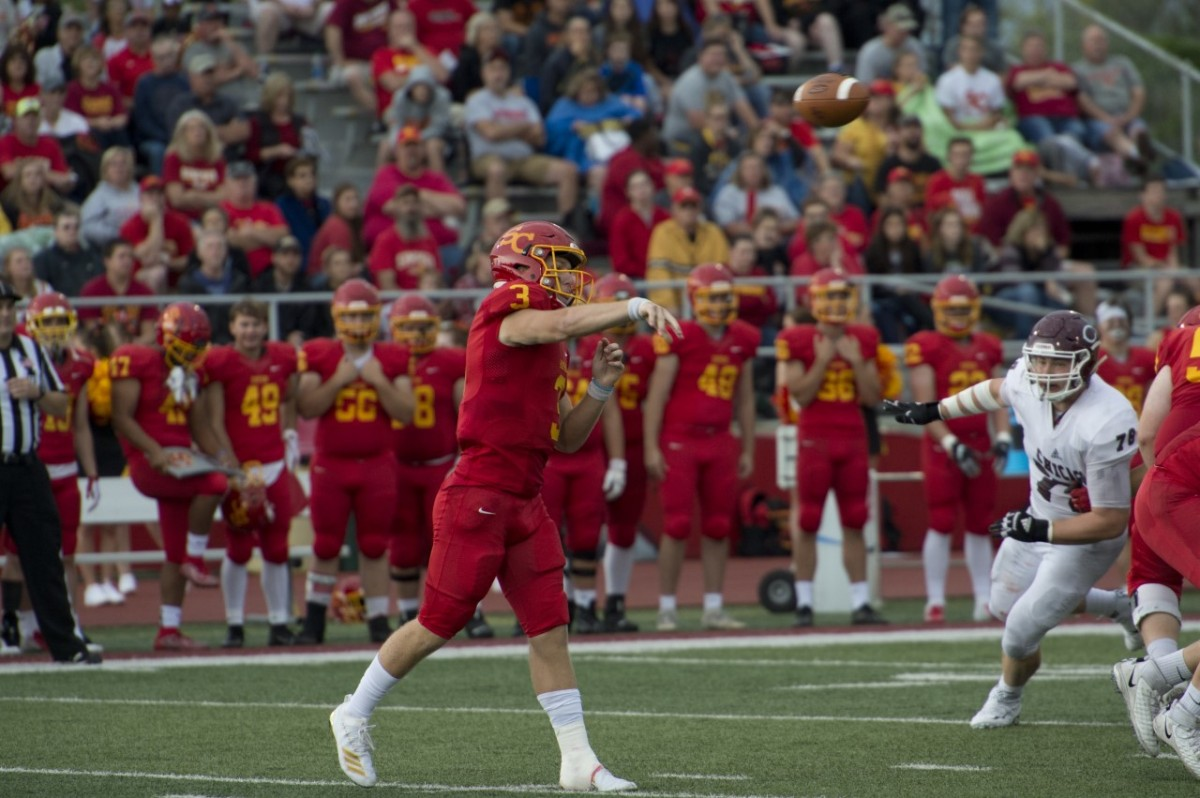 Tanner Krueger throws a pass in today's victory. Photo by Luke Behaunek.