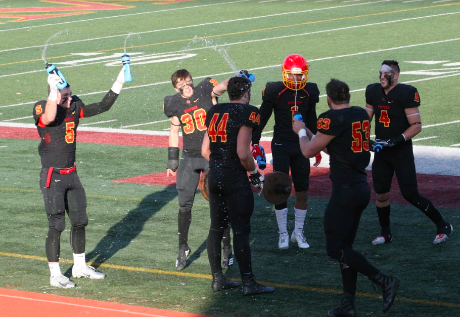 Members of Simpson's defense celebrate a fumble recovery late in the game. / Photo courtesy of Alan Bowles