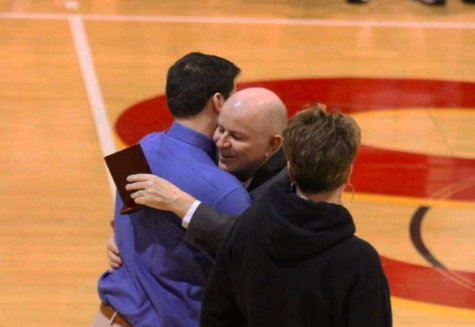Ben (left) hugs his dad, Brad (right) on senior night. /submitted by Ben Bjorkgren.