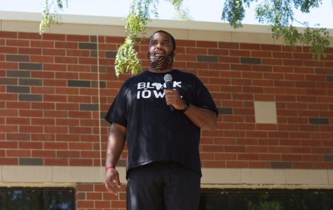 Coach Love speaks out at protest.