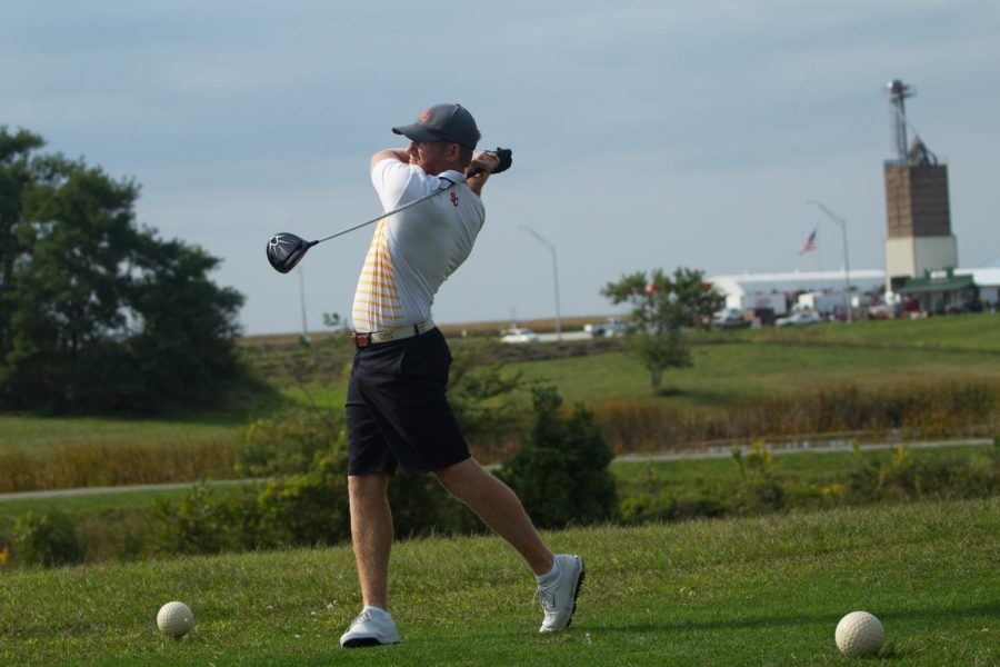Nathan Eaton practices his swing at golf practice.