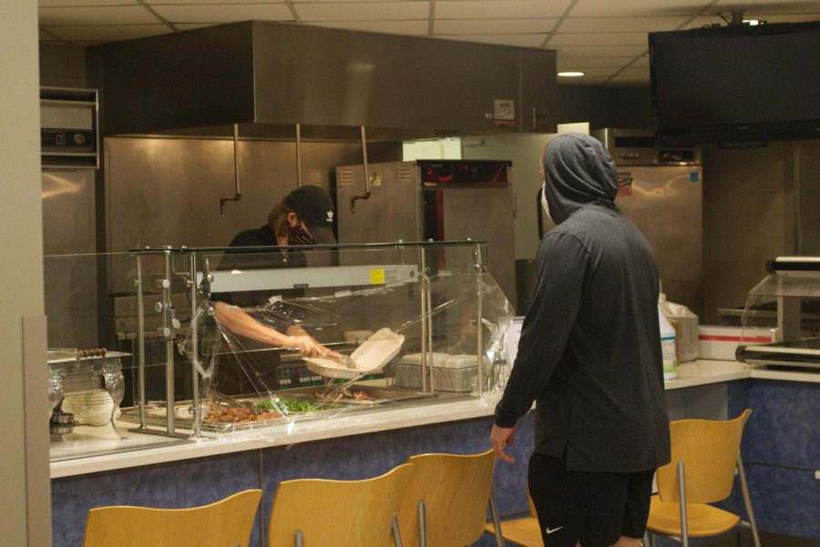 Students go through to-go line in Pfeiffer Dining Hall