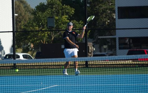 Chase Henry returns a serve at practice pre-diagnosis