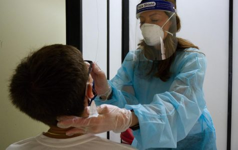 Simpson student gets tested at the Simpson COVID-19 TestIowa site.