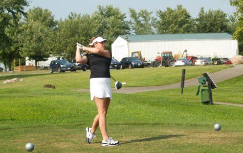 Emily Jansen practices her swing.