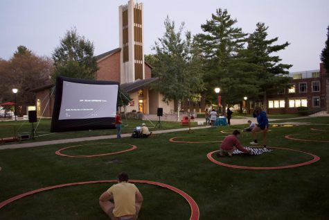 Students gather in the quad in front of the chapel to watch the screening.