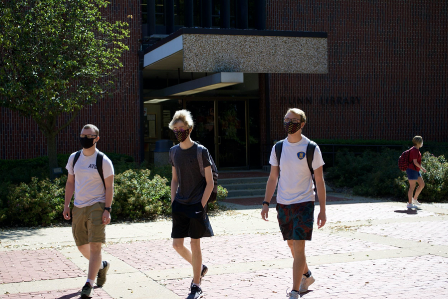 Students (read left to right) Zachary Ambrose, Levi Benes, and Alex Fuller walk to class together with masks on.