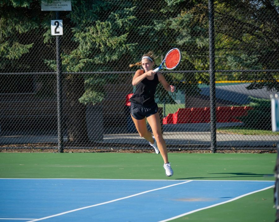 Anna Wanek serves a challenge for her competitors