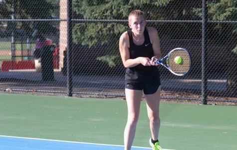 Junior Emily King slaps a backhand return in her No. 1 doubles match against Grand View University. She and Anna Wanek won the match 8-0.