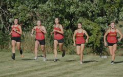 Women's cross country team races to the finish line.