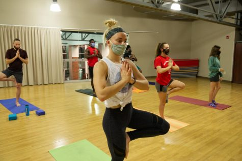 Student instructor Kelli Hanson leads Simpson students through a yoga class on Sunday, Nov. 8.