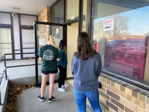 Students wait in line outside on-campus testing center.