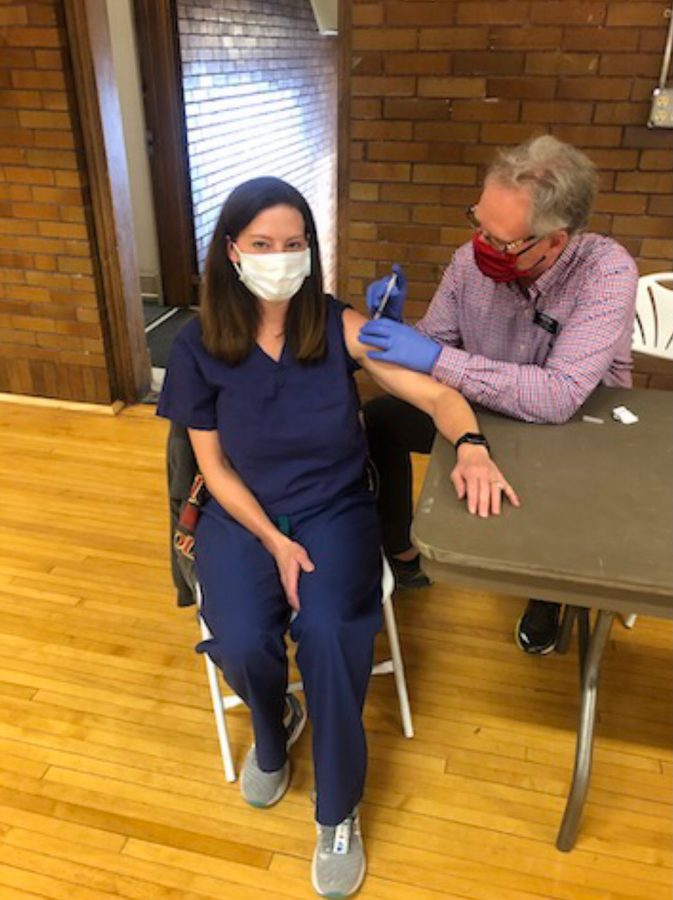 Director of Health Services Katie Lee receives the COVID-19 vaccine on campus. (Photo via COVIDResponse email on 1/4/21)