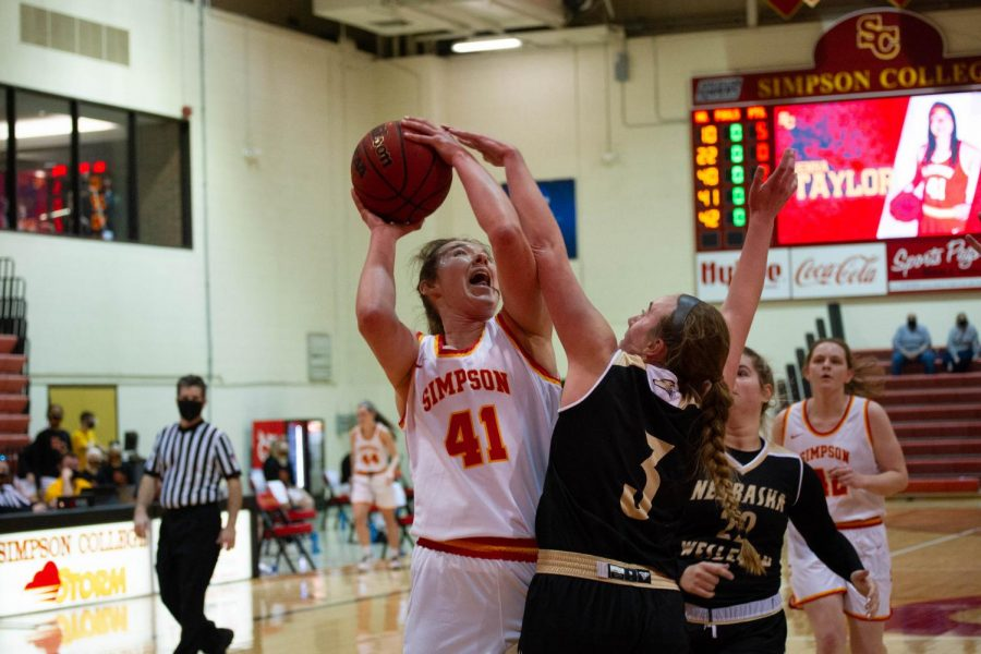 Jenna Taylor puts up a rebound for 2 points against Nebraska Wesleyan.