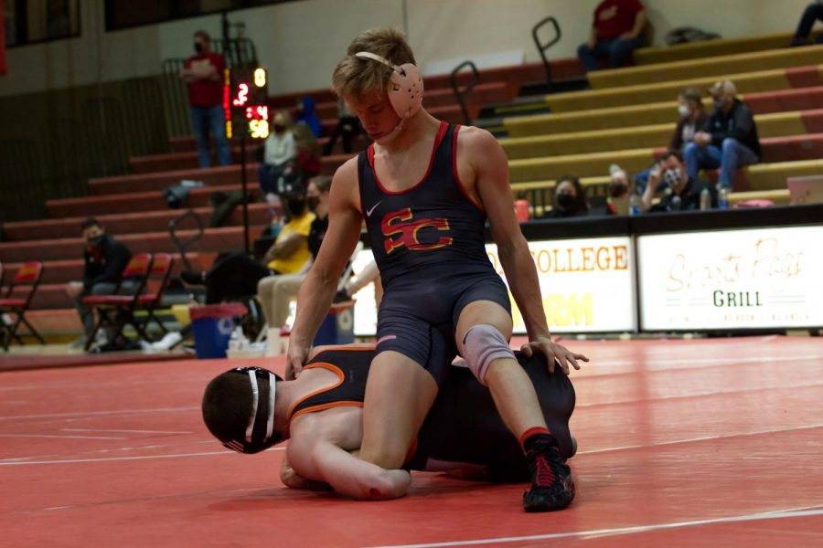 Dylan McChesney defeats Warburg's Owen McGlave by medical forfeit on Saturday, Jan. 30.