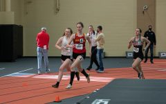 Glanz cruises around the corner during a sprint at Wartburg. The athlete and student coach was one of six Storm members in the indoor season to earn all-region honors.