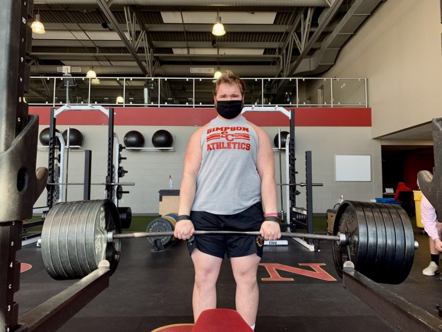 Vice-President of the Simpson College Powerlifting Club, Brennan Linn, starts training early.
