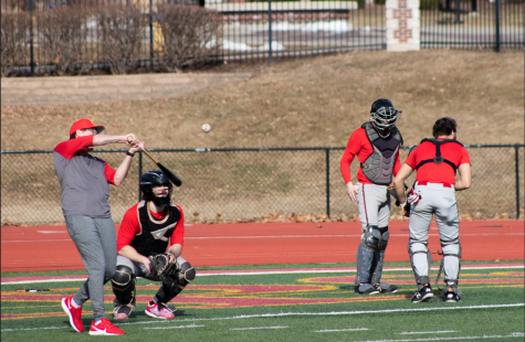 The Simpson baseball team practices on Bill Buxton Field with a pop fly drill.