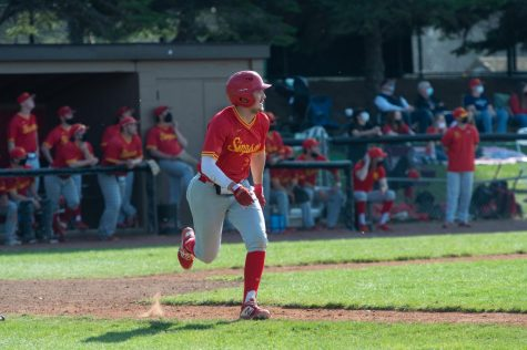 Senior second baseman Brandon Urias runs to first in 11-4 loss to Loras on April 3.