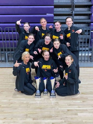 The Storm Dance Team shows off their two first-place trophies in Pom and Hip-Hop and their second-place trophy in Jazz from the ARC Cheer and Dance Championships.