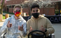 SGA members Will Keck and Frank Cruz pose on a cart during Campus Activity Day.