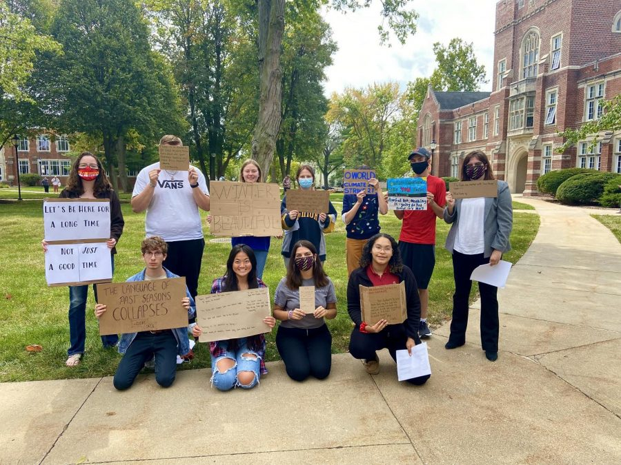 Students gather outside of College Hall to participate in Fridays for Future's global climate strike