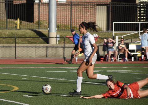 Cassie Nash breaks away from a defender to score a goal against Monmouth College.
