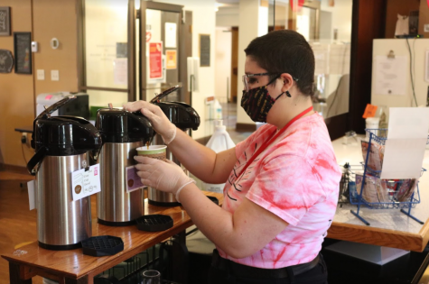Barista and Holy Grounds manager Eden Moad pours a cup of coffee. Holy Grounds has new locally sourced beans this semester.