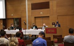 The Bread and Roses panelists and audience watch on as Nicole Crain speaks.