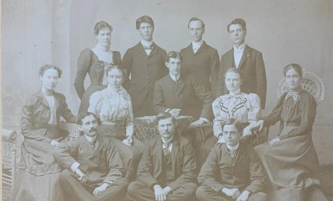The 1898 staff of The Simpsonian posed for the yearbook photo. Top row (left to right): Josie McCleary; H.L. Youtz; F.R. Sebolt, associate editor; S.M. Holiday, business manager. Middle row: Sadie Shepherd; Jennie Riggs, associate editor; Frank Henderson, editor; Roxanna Stewart, reporter; Lois Todd. Bottom row: James OMay, associate editor; B.W. McEldowney, Y.M.C.A.; J. Well Hancox, athletic editor.