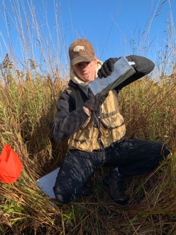 Senior Logan Lockard conducting research on small mammals at Neal Smith Wildlife Refuge